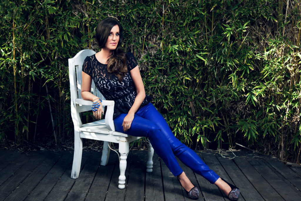 Patti Stanger on a chair